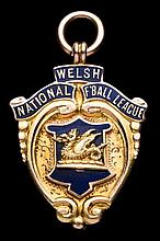 A 9ct. gold & enamel Welsh National League Division 1 runners-up medal seas