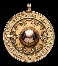 A 9ct. gold medal awarded to the Burnley trainer Charles Bates for the Engl
