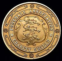 A 14ct. gold medal 1948 Football Association Charity Shield medal awarded t