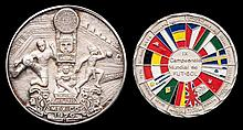 Two cased 1970 World Cup silver medallions,  one enamelled with the fla