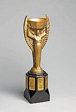 A cast brass replica of the Jules Rimet Trophy circa 1970,  a well mode