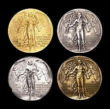 A complete set of four participation medals for