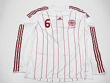 Lars Jacobsen: a white & red pinstriped Denmark