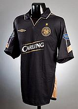 Jackie McNamara: a black & gold Celtic No.4 away