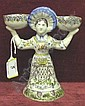 Quimper table centre figure with 2 faces holding 2 bowls aloft, with coat of arms on her skirt inscribed R Ma Vie, 7in, 3 small floral design