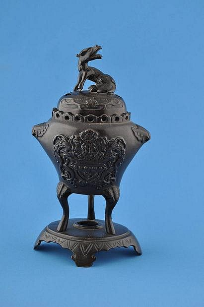 A Chinese bronze Koro with embossed decoration,