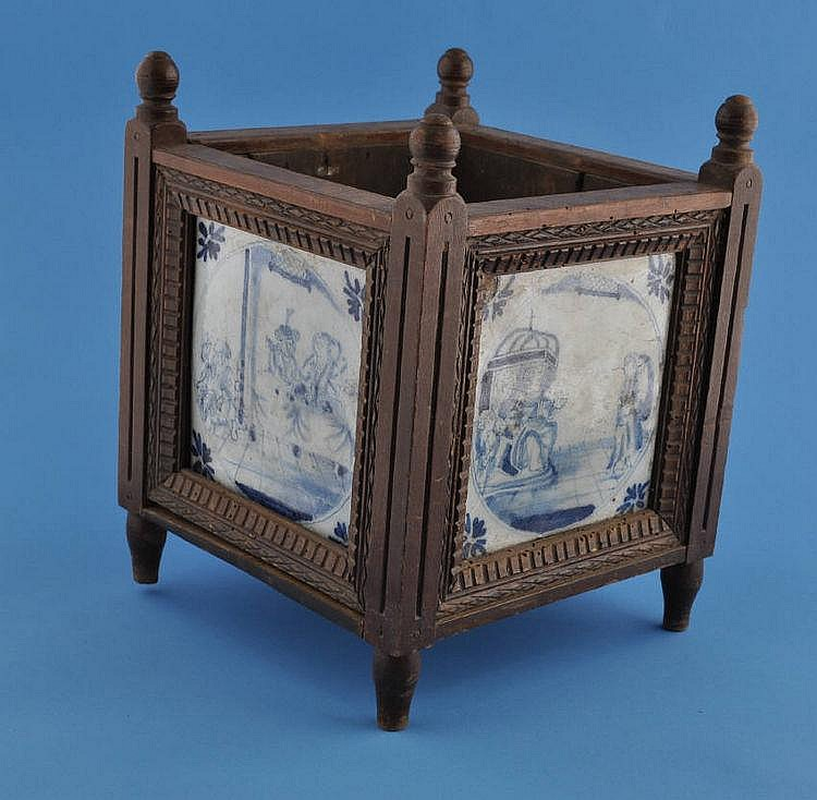 A carved wood jardiniere with 4 inset Antique blue