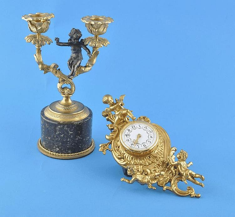 Gilt metal wall clock with applied cherubs, 7.5''