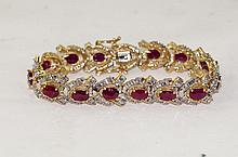 14kt y.g. Ruby & Diamond bracelet - Oval rubies