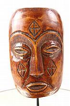 Fossilized Bone carved tribal mask diamond design