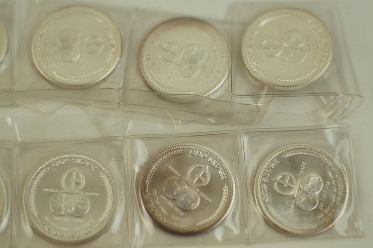 1972 World Trade coins - 14 one oz Silver pcs.