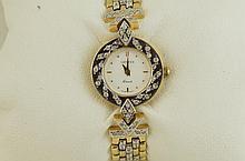 14kt Ladies gold & diamond Geneve watch