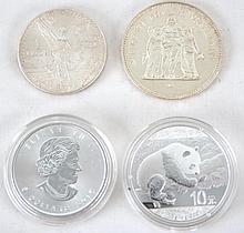 Four One ounce Silver Dollars