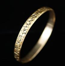 14 kt gold bracelet w embedded gold nuggets