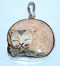 Sterling cat bone pendant