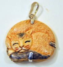 Carved bone cat pendant