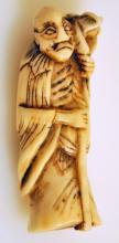 Bone vintage netuke/man w/ frog on shoulder