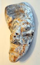Fossil oyster shell carved face