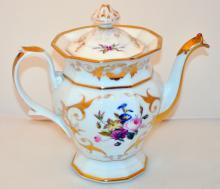 Antique teapots /gold trim on white