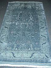 HAND KNOTTED WOOL AND SILK AREA RUG