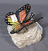 BRONZE BUTTERFLY ON ROCK