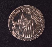 Another 1999 Millennium Quarter, December, struck on a Nickel 10c planchet