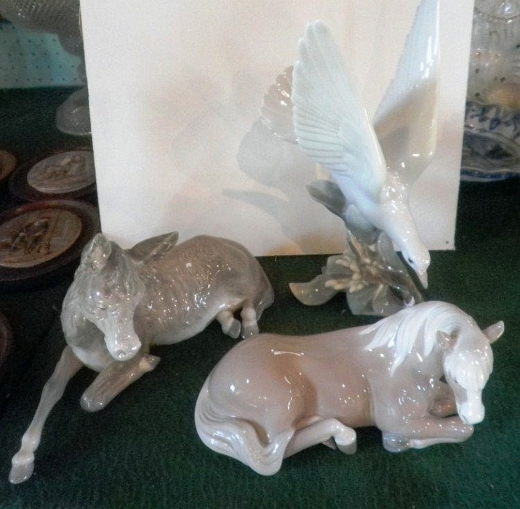 A Lladro model of a recumbent horse, another of a