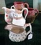 Two Continental majolica loop handled jugs, each