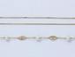 Lot en or, composé d'un bracelet ponctué de perles de culture et de maillons ajourés, et d'une chaîne maille forçat limée. Fermoirs anneaux ressort.. Poids brut total: 4.90 g.
