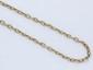 Chaîne en or, maille forçat, agrémentée d'un fermoir anneau ressort en or et argent.. Poids brut: 19.20 g. Long: 57.5 cm.