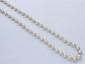 Collier composé d'une chute de perles de culture d'environ 4.5 à 7.7 mm, agrémenté d'un fermoir à cliquet en or invisible et d'une chaînette de sécurité. (chaînette cassée). Poids brut: 21.10 g. Long: 64 cm.