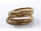 Bracelet serpent en or tressé, la tête ornée de roses diamantées, les yeux ponctués de pierres rouges. Travail de la fin du XIX° siècle. (légère déformation). Poids brut: 35.50 g.