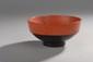 Bol à riz en bois laqué orange et noir. Dessous porte une étiquette de l'ESCALIER DE CRISTAL. Chine XIXème. H. 5 - Diam.: 10.5 cm