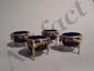 Série de 4 salières rondes en argent à 3 pieds griffes, les pilastres surmontés de sphinges ailées, les bordures à palmettes soulignées d'une frise ajourée. Avec 4 intérieurs en verre bleu.. Paris 1789-98.. Poids net : 282 g.