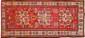 AKSTAFA (Caucase), Fin du 19ème siècle. Champ brique à trois médaillons octogonaux à crabes, sabliers, feuillages. . Bordure beige à décor de crabes et diamants. 255x120cm