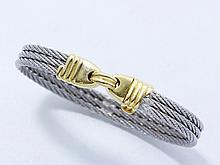 FRED ''Force 10''. Bracelet composé de 3 brins d'acier tressés, réunis par un fermoir en or 18 K godronné à double sécurité. Signé . Poids brut : 16.80 g. Tour de poignet: 18 cm.