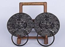 A pair of bronze mythological creature door handle ornament