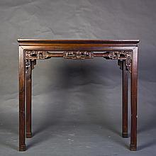 A HARDWOOD RECTANGULAR TABLE