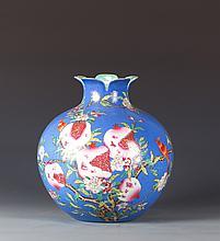 CHINESE BLUE GROUND FAMILLE ROSE PORCELAIN GLOBULAR VASE