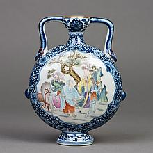 A CHINESE DOUCAI MOONFLASK PORCELAIN VASE