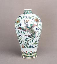 A FAMILLE ROSE PORCELAIN VASE OF DRAGON AND PHOENIX MOTIF