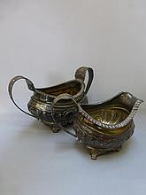 A Georgian silver cream jug and matching sucriere,
