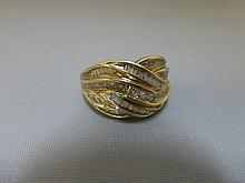A 9ct gold ring set with baguette and other