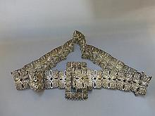 A highly decorative silver belt.