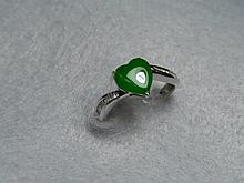 An 18ct white gold, jade and baguette diamond