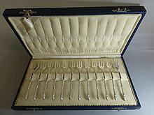 A set of twelve boxed Dutch silver pickle forks.