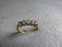 An 18ct gold five stone diamond ring, approx. 0.75