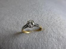 An 18ct gold and platinum solitaire ring, approx.