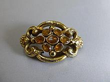A gold and citrine set brooch, unmarked.