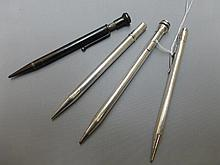 Four assorted silver cased propelling pencils.